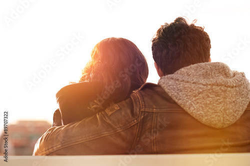 Young lovers at sunset Fototapeta