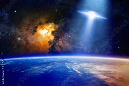 Foto op Canvas UFO Ufo approaches planet Earth