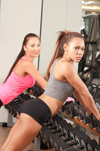 Two Athletic And Sexy Girls In The Gym