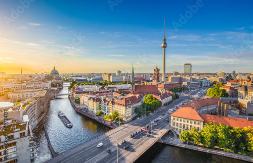 Poster Berlin Berlin skyline panorama with TV tower and Spree river at sunset, Germany