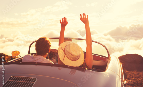 Photo  Young Couple Wathcing the Sunset in Vintage Sports Car