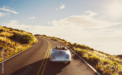 Coupe Driving on Country Road in Vintage Sports Car - 89739551