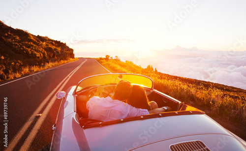 Pinturas sobre lienzo  Romantic Couple Driving on Beautiful Road at Sunset