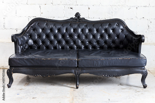 Juliste  vintage sofa on white wall.
