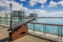 Old Cannon On The Promenade At Caudan Waterfront, Port Louis, Ma