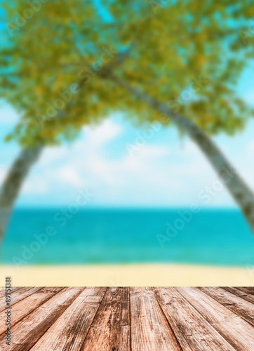 Foto auf Gartenposter Strand Blurred image of sea sky coconut tree with wooden under for put products.
