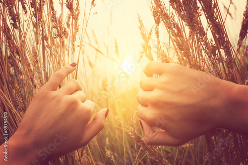 Girl relaxing in a wheat-field. Wallpaper Mural