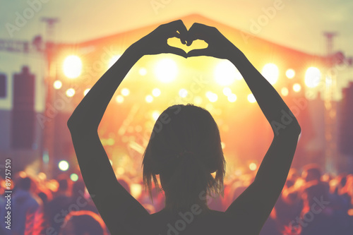 Silhouette of a girl while enjoying the concert. Wallpaper Mural