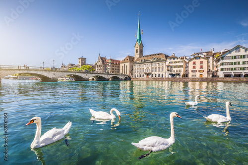 Fotobehang Zwaan Historic city center of Zürich with Fraumünster Church and swans on river Limmat, Canton of Zürich, Switzerland