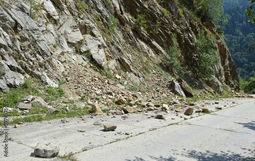 Rockfall in Carpathians where the road is covered with stones Fototapet