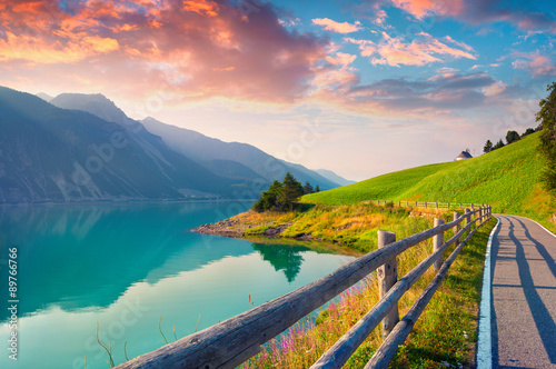 Plakat Bicycle path around Resia lake in the Italian Alps.