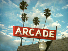Aged And Worn Vintage Photo Of Neon Arcade Sign With Palm Trees