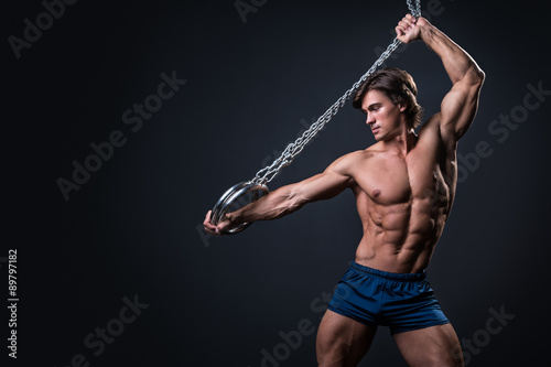 Photo sur Toile Gymnastique Muscular man and metallic rings