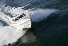 Elegant Speed Boat Sailing Through A Deep Ocean