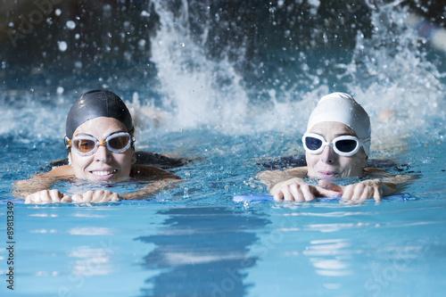 Obraz swimmers swimming with a swim board. - fototapety do salonu