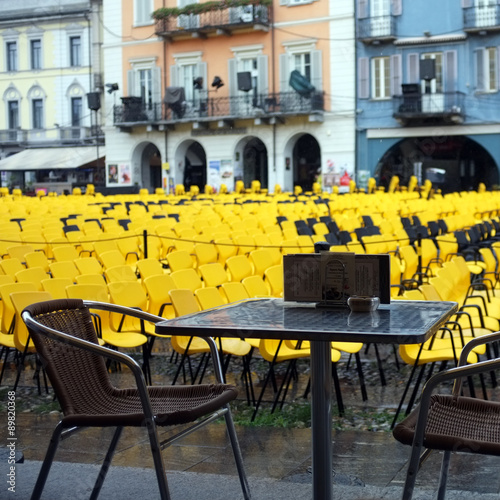View of the Locarno square with a lot of yellow chairs for the Locarno Film Fest Poster Mural XXL
