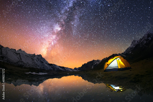 Fotobehang Kamperen 5 Billion Star Hotel. Camping in the mountains under the starry night sky.