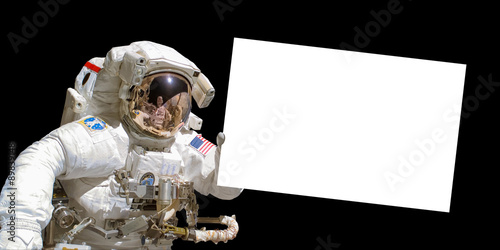 Deurstickers Nasa Astronaut in space holding a white blank board - elements of this image are provided by NASA