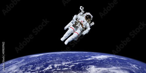 Deurstickers Nasa Astronaut in outer space over the planet earth. Elements of this image furnished by NASA