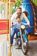 Man With Little Boy Having Fun