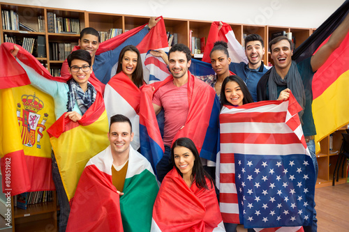 Fotografie, Obraz  Excited students presenting their countries with flags