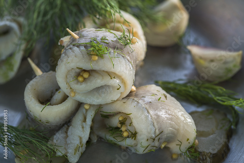 Fotografie, Obraz  Pickled rollmops herrings with dill