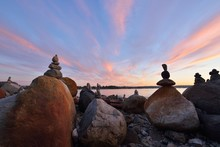 Balanced Rock Sculptures At English Bay During Sunset
