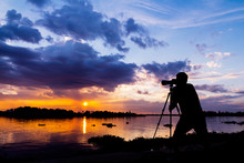 Silhouette Of Photographer Tak...