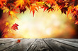 canvas print picture Autumn background with red leaves wooden planks