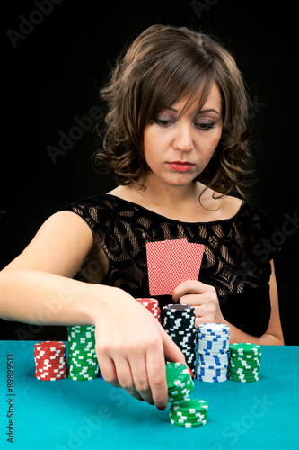 Young woman with gambling chips плакат