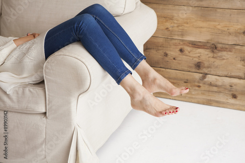 Fotografie, Obraz  Feet of the woman lying on the sofa