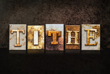Tithe Letterpress Concept On Dark Background