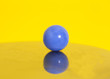 Blue ball on yellow background