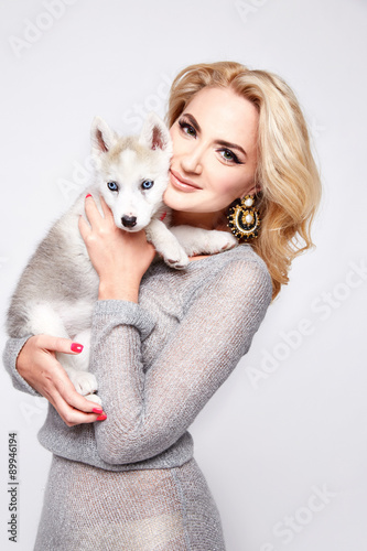 Beautiful sexy woman hug pets dog makeup dress blond Poster