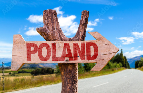 Poland wooden sign with road background
