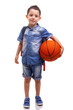 School boy posing with a basketball and backpack on white backgr