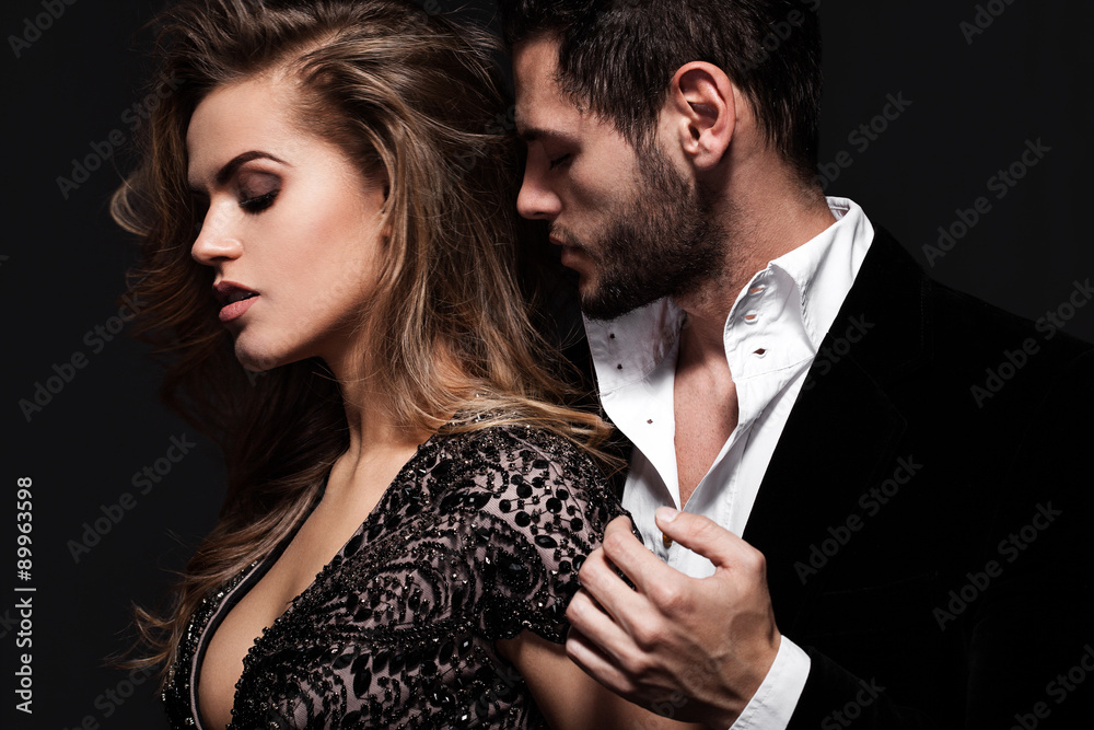 Fototapety, obrazy: Sexy elegant couple in the tender passion. Beautiful woman near the man.