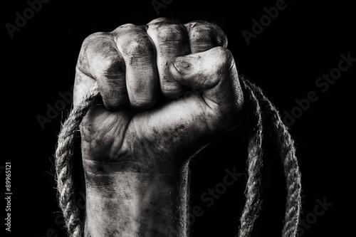 Fotografija Rope in male hand. Danger