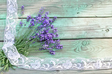 Bouquet Of Lavender With Lace On Wooden Background