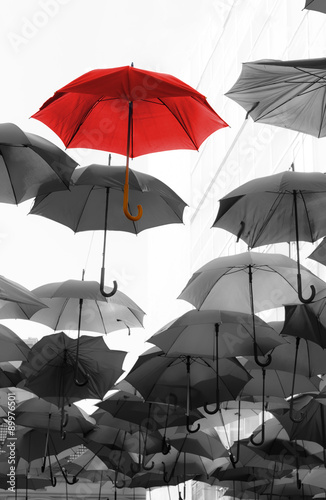 Fotografía  umbrella standing out from the crowd unique concept