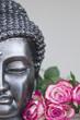 Buddha mit Rosen