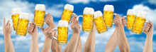 Hands With Beer Mugs On Blue C...