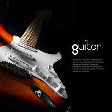 Electric Guitar On Dark Background. Removable Sample Text.