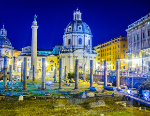 Fototapeta Part of the Trajan's Forum (Foro Di Traiano) at night showing some of the ruins, Trajan's Column, Santissimo Nome di Maria al Foro Traiano Church and other buildings and with copy space