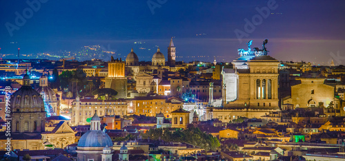 Tuinposter Rome night view over rome taken from the top of gianicolo hill. the most interesting monument on the horizon is snow white vittoriano building with distinct statue on top.