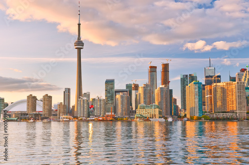Photo sur Toile Toronto The reflection of Toronto skyline at dusk in Ontario, Canada.