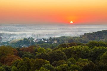 Obraz na Szkle Natura Exciting sunrise over fogged city and park, aerial view, Lviv