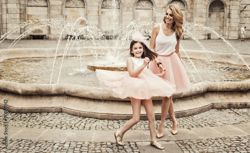 Fotografie, Obraz  Mother and daughter having fun in same outfits weared tutu skirt