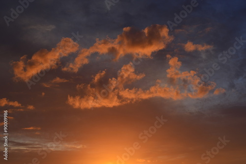 Fotografie, Obraz  Island sunset, U.K.  Lit low cloud at sunset.