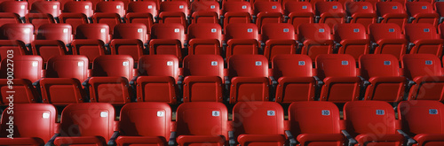 Fotografie, Obraz  These are bright red outdoor stadium seats with seats that fold up